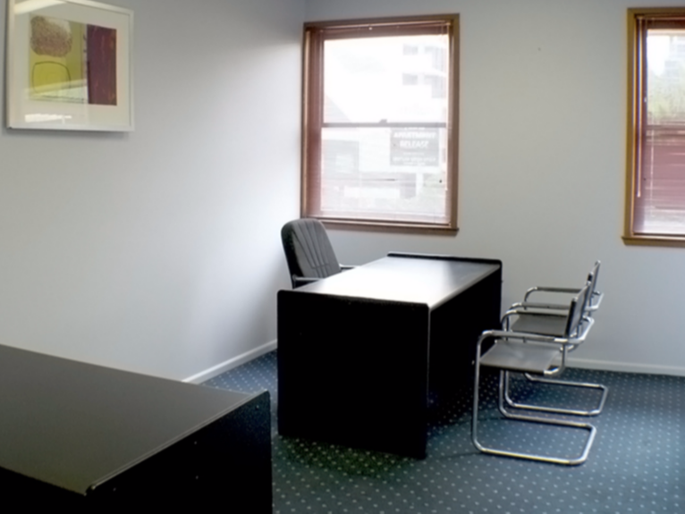 Single office with desk and visitors chairs
